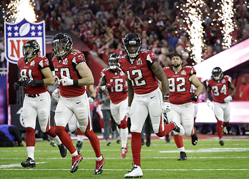 <div class='meta'><div class='origin-logo' data-origin='AP'></div><span class='caption-text' data-credit='AP'>Atlanta Falcons players take the field before the NFL Super Bowl 51 football game against the New England Patriots, Sunday, Feb. 5, 2017, in Houston. (AP Photo/David J. Phillip)</span></div>