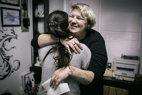 "<div class=""meta image-caption""><div class=""origin-logo origin-image ap""><span>AP</span></div><span class=""caption-text"">Tattoo artist Yevgeniya Zakhar hugs a woman she gave a tattoo to conceal a scar from a domestic violence attack, in Ufa, Russia. (AP Photo/Vadim Braydov)</span></div>"