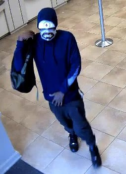 """<div class='meta'><div class='origin-logo' data-origin='none'></div><span class='caption-text' data-credit=''>The suspect is described as a black male in his middle 20's, approximately 5'10"""" tall, thin build.  He wore a skull mask that covered the lower half of his face.</span></div>"""