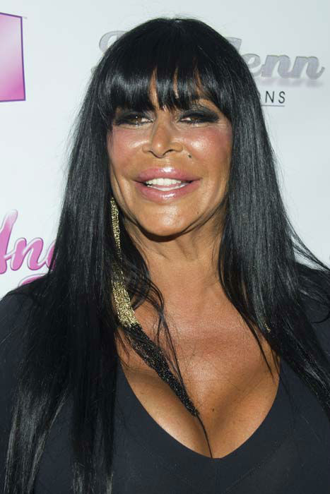 <div class='meta'><div class='origin-logo' data-origin='none'></div><span class='caption-text' data-credit='Charles Sykes/Invision/AP'>Angela Raiola, better know as Big Ang, arrives to the premiere of her VH1  reality show &#34;Big Ang&#34;</span></div>