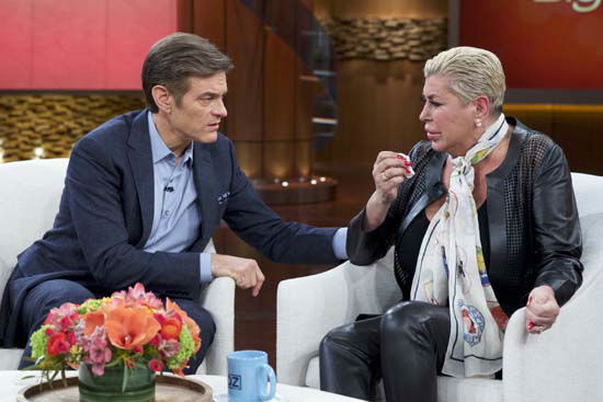 <div class='meta'><div class='origin-logo' data-origin='none'></div><span class='caption-text' data-credit='AP Photo/The Dr. Oz Show'>Dr. Mehmet Oz, left, comforts Angela &#34;Big Ang&#34; Raiola during a taping of &#34;The Dr. Oz Show,&#34; in New York.</span></div>