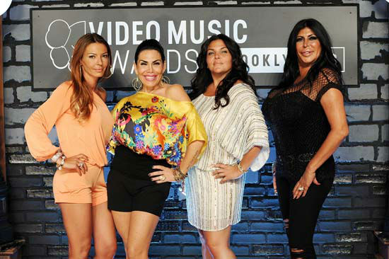 <div class='meta'><div class='origin-logo' data-origin='none'></div><span class='caption-text' data-credit='Evan Agostini/Invision/AP'>Drita Davanzo, Renee Graziano and Angela 'Big Ang' Raiola arrive at the MTV Video Music Awards on Sunday, Aug. 25, 2013.</span></div>