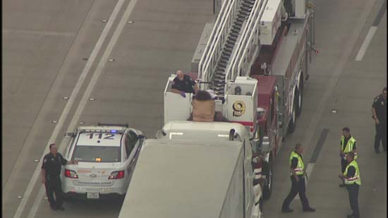 <div class='meta'><div class='origin-logo' data-origin='KTRK'></div><span class='caption-text' data-credit='KTRK'>A naked woman who refuses to come down from the roof of big rig cab has stopped traffic on a Texas highway</span></div>