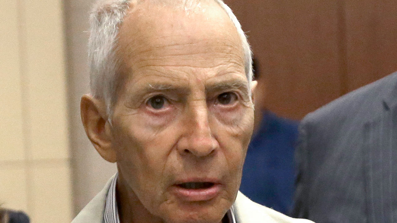<div class='meta'><div class='origin-logo' data-origin='none'></div><span class='caption-text' data-credit='Photo/Pat Sullivan'>In this Aug. 15, 2014 file photo, New York City real estate heir Robert Durst leaves a Houston courtroom</span></div>