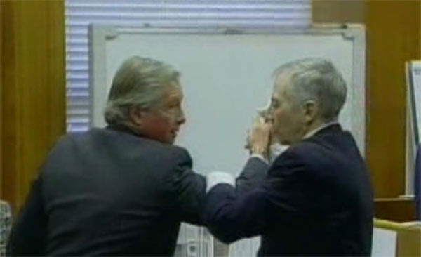 <div class='meta'><div class='origin-logo' data-origin='none'></div><span class='caption-text' data-credit=''>Robert Durst in the courtroom demonstrating how he defended himself with one of his attorneys during the 2003 trial.</span></div>