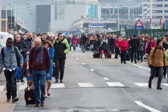 <div class='meta'><div class='origin-logo' data-origin='AP'></div><span class='caption-text' data-credit='AP Photo/Geert Vanden Wijngaert'>People walk away from Brussels airport after explosions rocked the facility in Brussels, Belgium, Tuesday, March 22, 2016.</span></div>