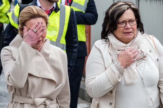 <div class='meta'><div class='origin-logo' data-origin='none'></div><span class='caption-text' data-credit='AP Photo/Geert Vanden Wijngaert'>People react as they walk away from Brussels airport after explosions rocked the facility in Brussels, Belgium, Tuesday, March 22, 2016.</span></div>