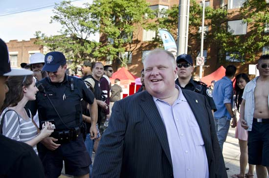 """<div class=""""meta image-caption""""><div class=""""origin-logo origin-image ktrk""""><span>KTRK</span></div><span class=""""caption-text"""">Mayor of Toronto Rob Ford visits the 8th National Bank Salsa on St. Clair, Canada's largest Latino-themed street festival (Shutterstock/rmnoa357)</span></div>"""