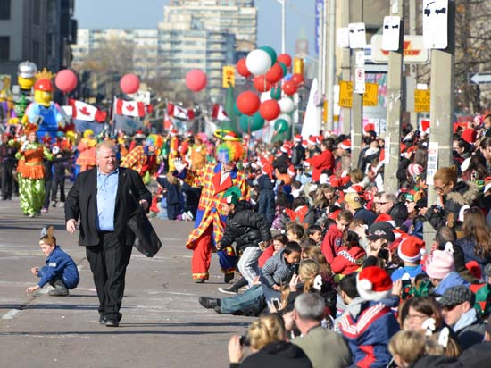 <div class='meta'><div class='origin-logo' data-origin='KTRK'></div><span class='caption-text' data-credit='Shutterstock/Canadapanda'>Mayor Rob Ford runs down the street during the 108th Santa Claus Parade in Toronto, Canada on November 18, 2012</span></div>