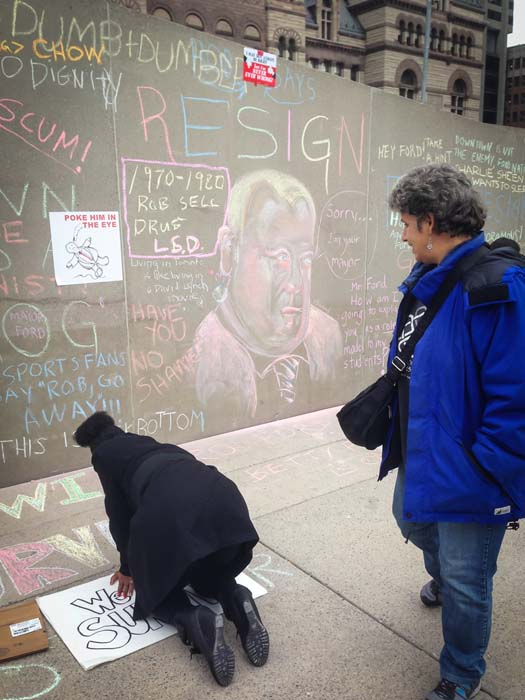 """<div class=""""meta image-caption""""><div class=""""origin-logo origin-image ktrk""""><span>KTRK</span></div><span class=""""caption-text"""">A [rotester against the mayor Rob Ford writes on the floor in Toronto, Canada on November 16, 2013 (Shutterstock/Canadapanda)</span></div>"""