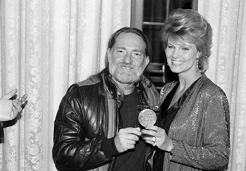 "<div class=""meta image-caption""><div class=""origin-logo origin-image ap""><span>AP</span></div><span class=""caption-text"">Willie Nelson poses with his wife, Connie, after receiving the Lifetime Achievement Award at the Songwriter's Hall of Fame Awards ceremony on March 7, 1983. (AP Photo)</span></div>"