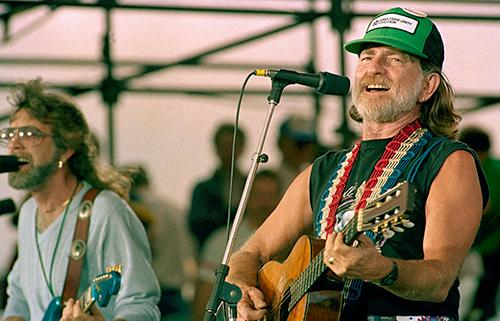 "<div class=""meta image-caption""><div class=""origin-logo origin-image ap""><span>AP</span></div><span class=""caption-text"">Willie Nelson performs during opening set at the FarmAid benefit concert September 22, 1985 at Champaign, Illinois. (AP Photo/Mark Elias)</span></div>"