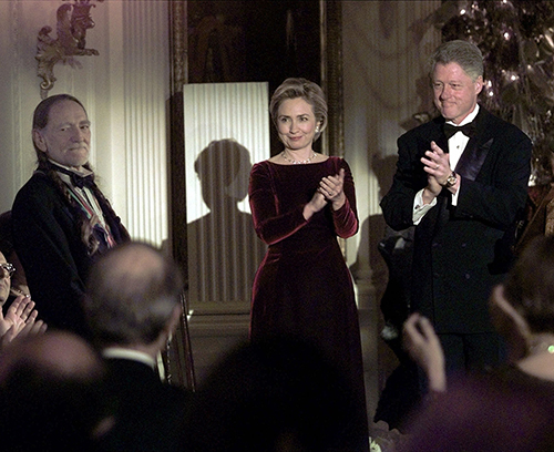 "<div class=""meta image-caption""><div class=""origin-logo origin-image ap""><span>AP</span></div><span class=""caption-text"">President Clinton and first lady Hillary Rodham Clinton applaud Willie Nelson at the White House on Sunday, Dec. 6,1998, during a reception for Kennedy Center Award winners. (AP Photo/Ron Edmonds)</span></div>"