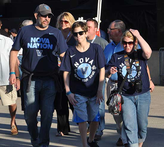 <div class='meta'><div class='origin-logo' data-origin='none'></div><span class='caption-text' data-credit='abc13'>Photos from inside and outside NRG Stadium as fans game pumped for Monday's title game between North Carolina and Villanova.</span></div>