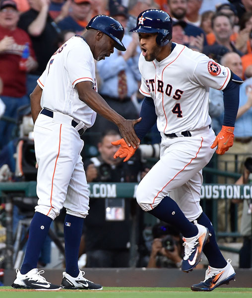 "<div class=""meta image-caption""><div class=""origin-logo origin-image none""><span>none</span></div><span class=""caption-text"">Houston Astros' George Springer, right, shakes hands with third base coach Gary Pettis after hitting a leadoff solo home run off Seattle Mariners starting pitcher Felix Hernandez. (AP Photo/Eric Christian Smith)</span></div>"