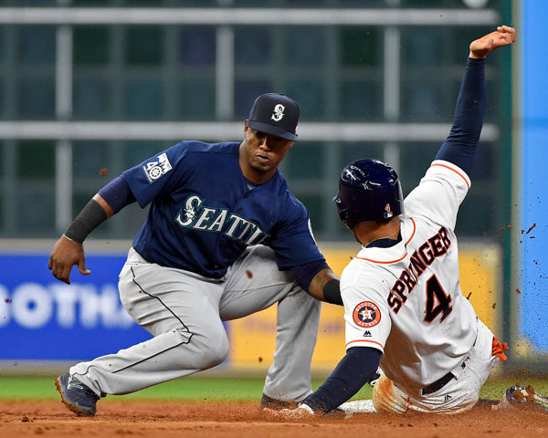 <div class='meta'><div class='origin-logo' data-origin='none'></div><span class='caption-text' data-credit='AP Photo/Eric Christian Smith'>Houston Astros' George Springer (4) is tagged out by Seattle Mariners shortstop Jean Segura while attempting to steal second during the third inning of the baseball game.</span></div>