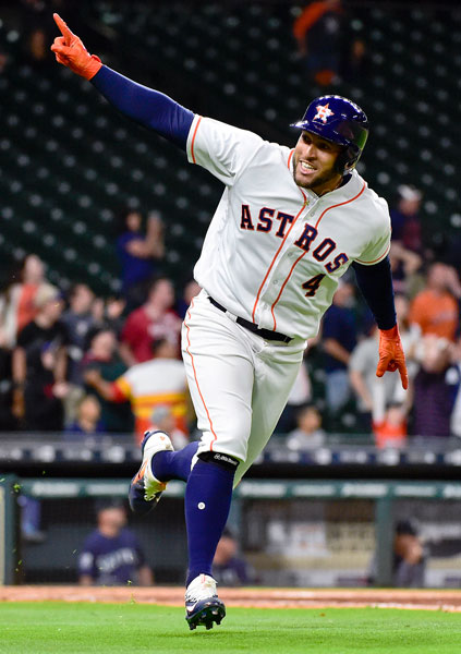 <div class='meta'><div class='origin-logo' data-origin='none'></div><span class='caption-text' data-credit='AP Photo/Eric Christian Smith'>Houston Astros' George Springer rounds the bases after hitting the game-winning three-run home run in the 13th inning of a baseball game against the Seattle Mariners.</span></div>