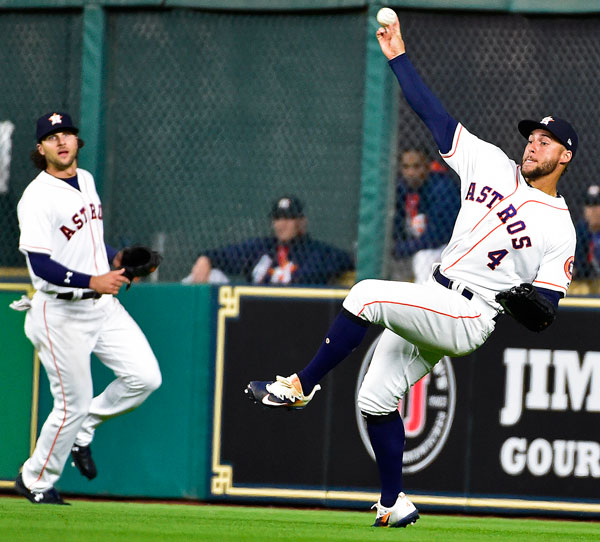 <div class='meta'><div class='origin-logo' data-origin='none'></div><span class='caption-text' data-credit='AP Photo/Eric Christian Smith'>Astros right fielder George Springer (4) relays the ball to second base after catching the fly ball of Seattle Mariners' Danny Valencia as center fielder Jake Marisnick looks on.</span></div>