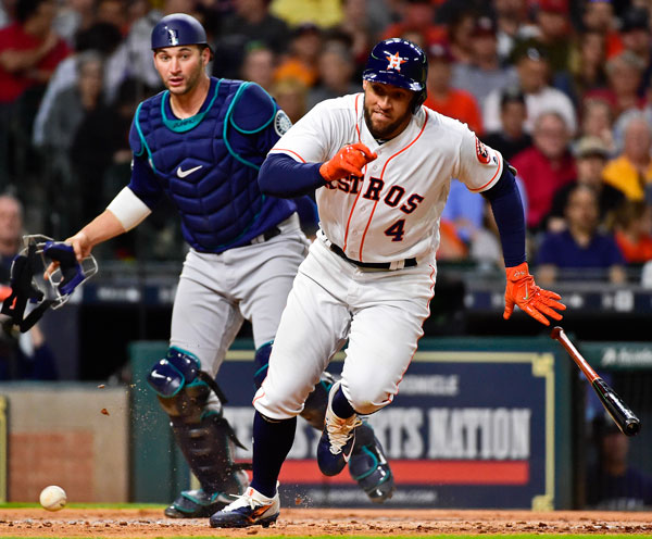 <div class='meta'><div class='origin-logo' data-origin='none'></div><span class='caption-text' data-credit='AP Photo/Eric Christian Smith'>Houston Astros' George Springer (4) runs to first base after striking out on a wild pitch by Seattle Mariners starting pitcher James Paxton as catcher Mike Zunino watches.</span></div>