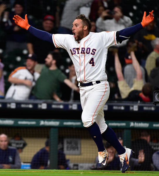 <div class='meta'><div class='origin-logo' data-origin='none'></div><span class='caption-text' data-credit='AP Photo/Eric Christian Smith'>Houston Astros' George Springer celebrates his game-winning three-run home run in the 13th inning of a baseball game against the Seattle Mariners, Wednesday, April 5, 2017.</span></div>