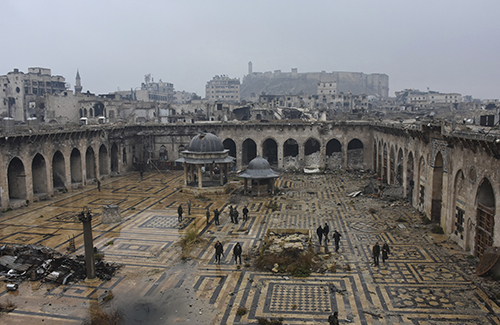 <div class='meta'><div class='origin-logo' data-origin='AP'></div><span class='caption-text' data-credit='SANA via AP'>This photo released by the Syrian official news agency  shows Syrian troops and pro-government gunmen marching walk inside the destroyed Grand Umayyad mosque in Aleppo.</span></div>