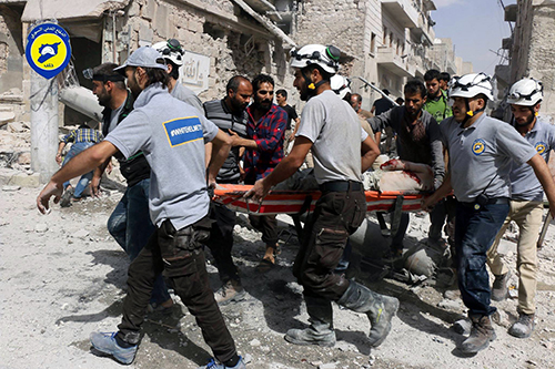 <div class='meta'><div class='origin-logo' data-origin='AP'></div><span class='caption-text' data-credit='Syrian Civil Defense White Helmets via AP, File'>Rescue workers work the site of airstrikes in the al-Sakhour neighborhood of the rebel-held part of eastern Aleppo, Syria.</span></div>