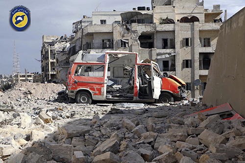 <div class='meta'><div class='origin-logo' data-origin='AP'></div><span class='caption-text' data-credit='Syrian Civil Defense White Helmets via AP'>A destroyed ambulance is seen outside the Syrian Civil Defense main center after airstrikes in Ansari neighborhood in the rebel-held part of eastern Aleppo, Syria.</span></div>