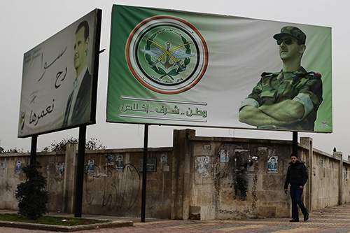<div class='meta'><div class='origin-logo' data-origin='AP'></div><span class='caption-text' data-credit='AP Photo/Hassan Ammar'>In this picture taken Dec. 5, 2016, a Syrian man walks by posters of Syrian President Assad with Arabic that read &#34;Homeland, honor, fidelity. Together we will build it,&#34; in Aleppo,</span></div>