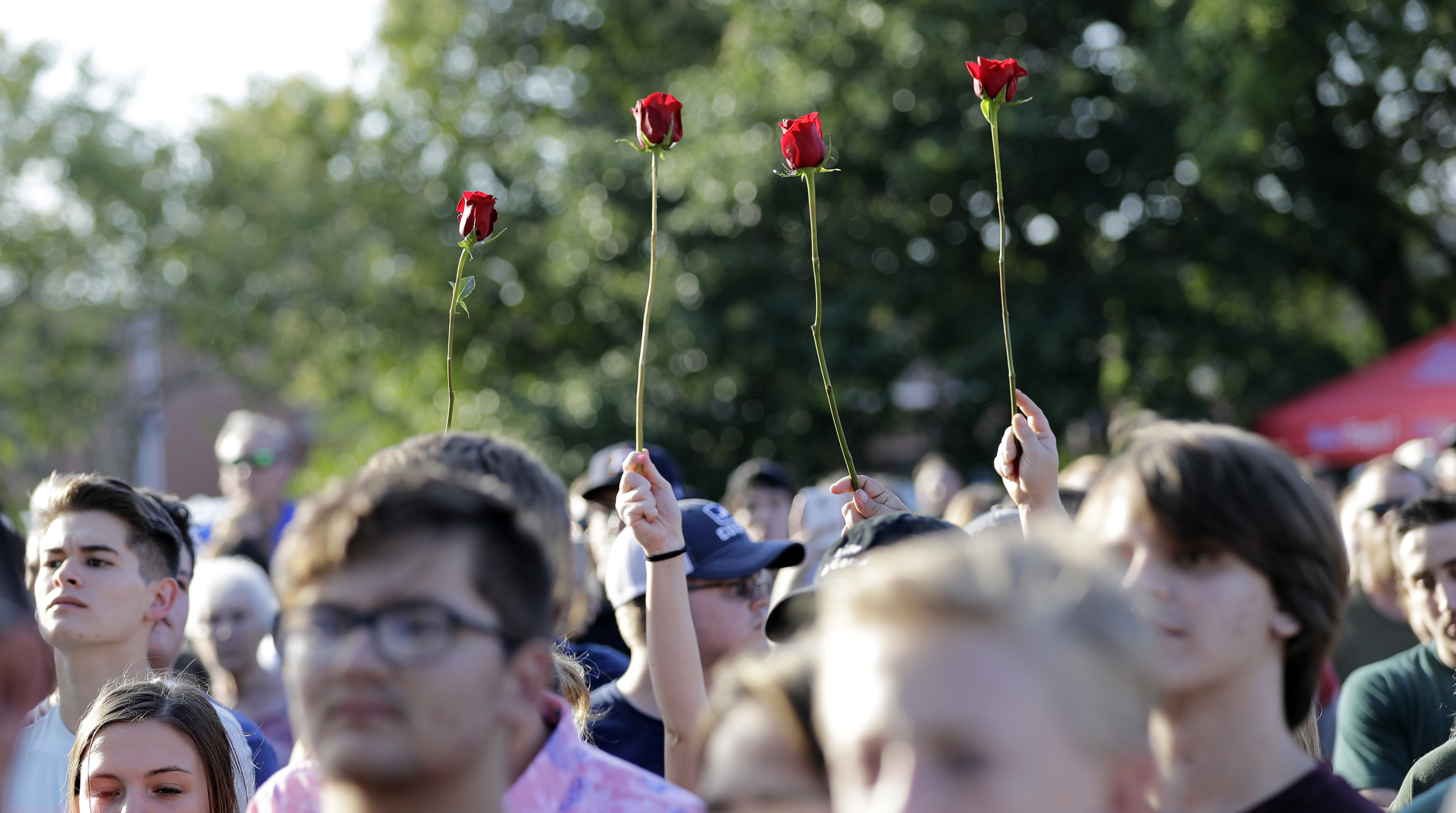 <div class='meta'><div class='origin-logo' data-origin='AP'></div><span class='caption-text' data-credit='AP'>Roses are held up during a prayer vigil following a shooting at Santa Fe High School in Santa Fe, Texas, on Friday, May 18, 2018. (AP Photo/David J. Phillip)</span></div>