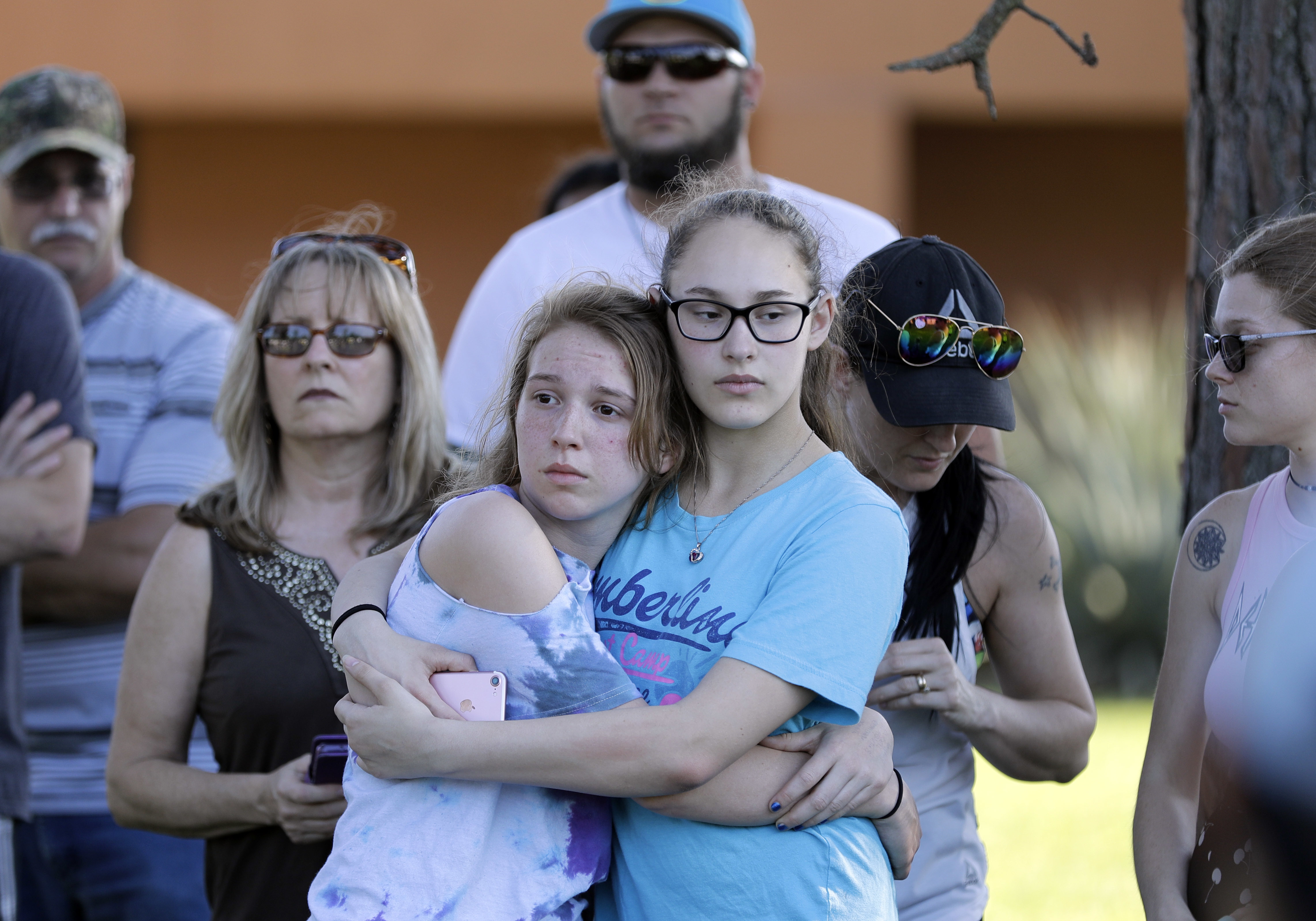 <div class='meta'><div class='origin-logo' data-origin='AP'></div><span class='caption-text' data-credit='AP'>Mourners wait for the start of a prayer vigil following a deadly shooting at Santa Fe High School in Santa Fe, Texas, on Friday, May 18, 2018.  (AP Photo/David J. Phillip)</span></div>