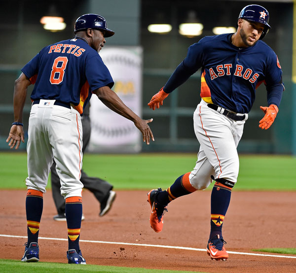 <div class='meta'><div class='origin-logo' data-origin='none'></div><span class='caption-text' data-credit='AP Photo/Eric Christian Smith'>Houston Astros' George Springer, right, shakes hands with third base coach Gary Pettis after hitting a solo home run off Kansas City Royals starting pitcher Nathan Karns.</span></div>