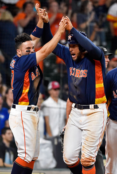 <div class='meta'><div class='origin-logo' data-origin='none'></div><span class='caption-text' data-credit='AP Photo/Eric Christian Smith'>Houston Astros' George Springer, right, celebrates scoring the winning run on Evan Gattis' bases-loaded walk with Jose Altuve in the 12th inning of the game.</span></div>