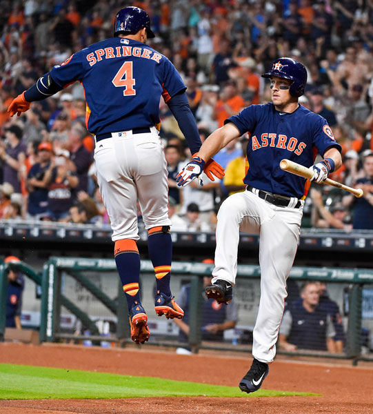 <div class='meta'><div class='origin-logo' data-origin='none'></div><span class='caption-text' data-credit='AP Photo/Eric Christian Smith'>Houston Astros' George Springer, left, celebrates his solo home run with Alex Bregman, right, in the first inning of a baseball game, Sunday, April 9, 2017, in Houston.</span></div>