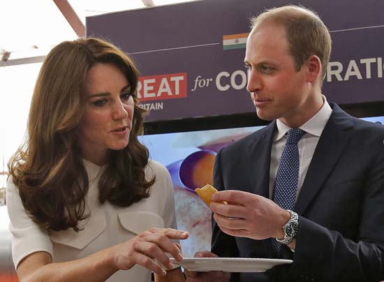 "<div class=""meta image-caption""><div class=""origin-logo origin-image ap""><span>AP</span></div><span class=""caption-text"">Britain's Prince William eats a ""dosa"",  or a rice pancake as his wife Kate, the Duchess of Cambridge, watches (Danish Siddiqui/Pool Photo via AP)</span></div>"