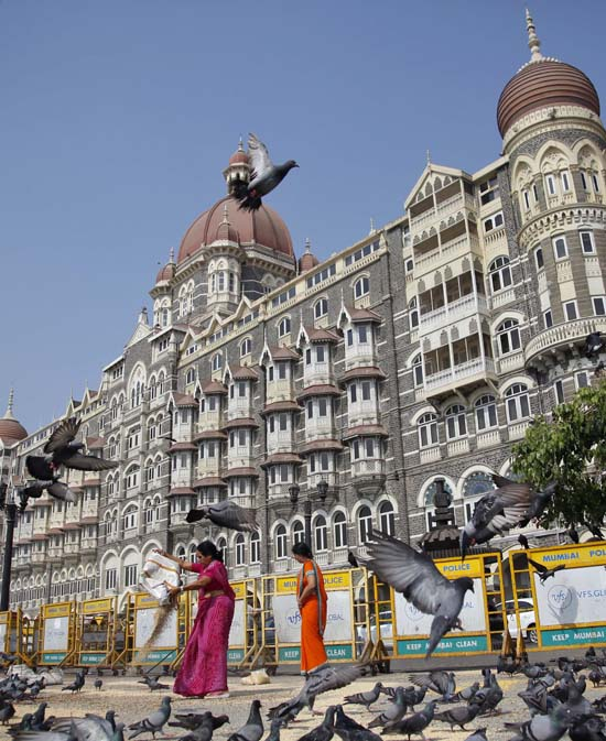 "<div class=""meta image-caption""><div class=""origin-logo origin-image ap""><span>AP</span></div><span class=""caption-text"">Women feed pigeons in front of the Taj Palace hotel in Mumbai, India (AP Photo/Rajanish Kakade)</span></div>"