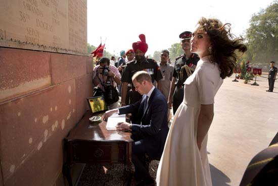 "<div class=""meta image-caption""><div class=""origin-logo origin-image ap""><span>AP</span></div><span class=""caption-text"">Britain's Prince William, signs visitor's book  as his wife Kate, the Duchess of Cambridge looks on after paying their tributes at the India Gate war memorial (Manish Swarup/Pool Photo via AP)</span></div>"