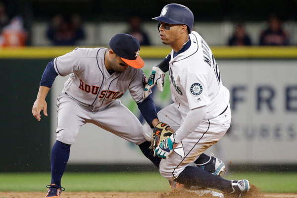 <div class='meta'><div class='origin-logo' data-origin='none'></div><span class='caption-text' data-credit='AP Photo/Elaine Thompson'>Seattle Mariners' Leonys Martin, right, looks up after stealing second base as Houston Astros second baseman Jose Altuve puts on a tag in a baseball game Monday, April 10, 2017.</span></div>