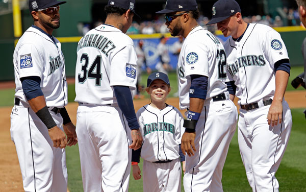 "<div class=""meta image-caption""><div class=""origin-logo origin-image none""><span>none</span></div><span class=""caption-text"">Sophia Robinson, 8, is greeted at home after her ceremonial run around the bases by Seattle Mariners Nelson Cruz, left, Felix Hernandez, Robinson Cano and Kyle Seager. (AP Photo/Elaine Thompson)</span></div>"