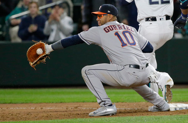 <div class='meta'><div class='origin-logo' data-origin='none'></div><span class='caption-text' data-credit='AP Photo/Ted S. Warren'>Houston Astros first baseman Yuli Gurriel makes a catch during a baseball game against the Seattle Mariners, Tuesday, April 11, 2017, in Seattle.</span></div>
