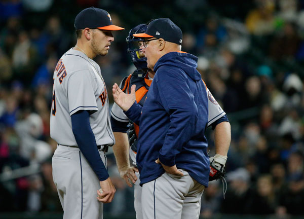 <div class='meta'><div class='origin-logo' data-origin='none'></div><span class='caption-text' data-credit='AP Photo/Ted S. Warren'>Houston Astros starting pitcher Joe Musgrove, left, and catcher Brian McCann talk with pitching coach Brent Strom, right, during the fifth inning.</span></div>