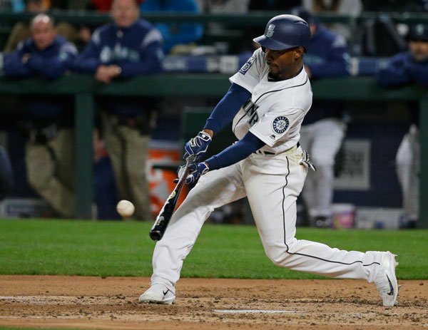 <div class='meta'><div class='origin-logo' data-origin='none'></div><span class='caption-text' data-credit='AP Photo/Ted S. Warren'>Seattle Mariners' Jarrod Dyson hits a sacrifice fly to score Carlos Ruiz in the fifth inning of a baseball game against the Houston Astros, Tuesday, April 11, 2017, in Seattle.</span></div>