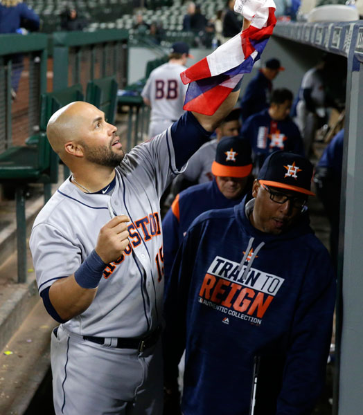 "<div class=""meta image-caption""><div class=""origin-logo origin-image none""><span>none</span></div><span class=""caption-text"">Houston Astros right fielder Carlos Beltran returns a Puerto Rican flag after autographing it for a fan after a baseball game against the Seattle Mariners, Tuesday, April 11, 2017. (AP Photo/Ted S. Warren)</span></div>"