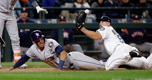 "<div class=""meta image-caption""><div class=""origin-logo origin-image none""><span>none</span></div><span class=""caption-text"">Seattle Mariners relief pitcher Dan Altavilla watches the ball pop loose from his glove as Houston Astros' Carlos Correa scores on a wild pitch in the seventh inning. (AP Photo/Elaine Thompson)</span></div>"