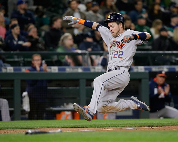 "<div class=""meta image-caption""><div class=""origin-logo origin-image none""><span>none</span></div><span class=""caption-text"">Houston Astros' Josh Reddick scores against the Seattle Mariners in the seventh inning of a baseball game Wednesday, April 12, 2017, in Seattle. (AP Photo/Elaine Thompson)</span></div>"