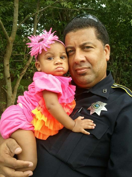 <div class='meta'><div class='origin-logo' data-origin='KTRK'></div><span class='caption-text' data-credit='KTRK'>Deputy Constable Alden Clopton and his daughter</span></div>