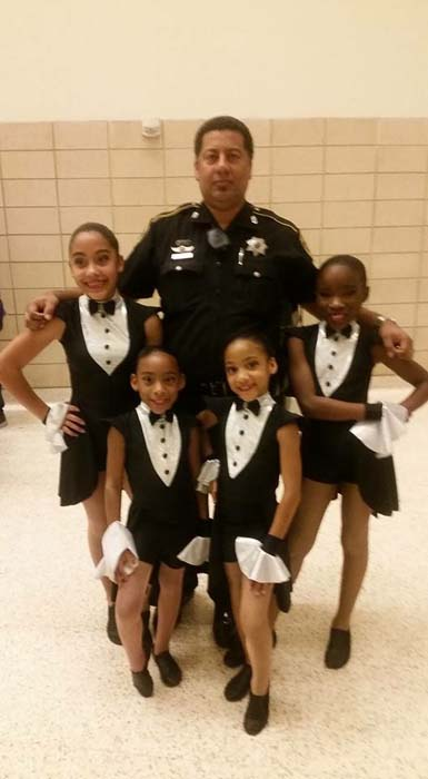<div class='meta'><div class='origin-logo' data-origin='KTRK'></div><span class='caption-text' data-credit='KTRK'>Deputy Constable Alden Clopton and his daughters</span></div>