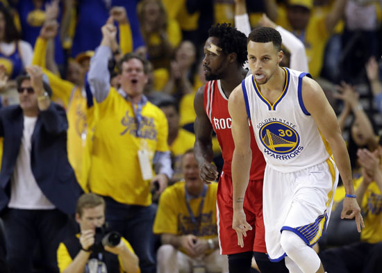<div class='meta'><div class='origin-logo' data-origin='AP'></div><span class='caption-text' data-credit='Marcio Jose Sanchez'>Golden State Warriors' Stephen Curry (30) celebrates after making a 3-point basket against the Houston Rockets during the first half.</span></div>