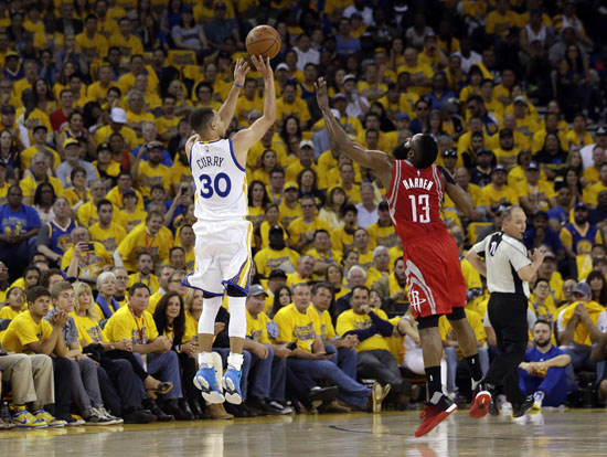 <div class='meta'><div class='origin-logo' data-origin='AP'></div><span class='caption-text' data-credit='Marcio Jose Sanchez'>Golden State Warriors' Stephen Curry (30) makes a 3-point basket over Houston Rockets' James Harden (13) during the first half.</span></div>