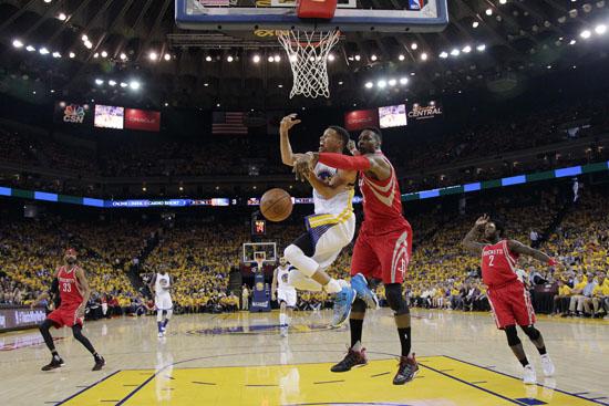 <div class='meta'><div class='origin-logo' data-origin='AP'></div><span class='caption-text' data-credit='Marcio Jose Sanchez'>Houston Rockets' Dwight Howard, center, right, blocks a shot attempt from Golden State Warriors' Stephen Curry, center left, during the first half.</span></div>
