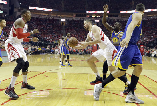 "<div class=""meta image-caption""><div class=""origin-logo origin-image ap""><span>AP</span></div><span class=""caption-text"">Rockets' Donatas Motiejunas passes under the basket to teammate Dwight Howard, left, as Warriors' Draymond Green (23) and Andrew Bogut, right, defend during the first half. (David J. Phillip)</span></div>"